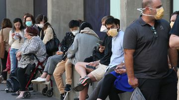 People line up outside the Royal Melbourne Hosital for coronavirus testing in Melbourne, Tuesday, March 10, 2020.