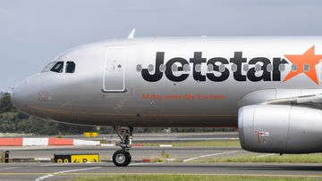 Jetstar plane on tarmac.