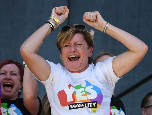 Christine Forster, the sister of former Prime Minister Tony Abbott, celebrates after watching the same sex marriage vote result announcement. (AAP)