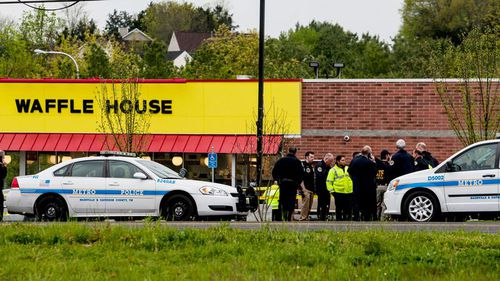 Four people were shot dead  by a near-naked gunman at the Nashville restaurant. (AP/AAP)