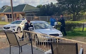 Two men charged over alleged police pursuit across Adelaide and injuring officer