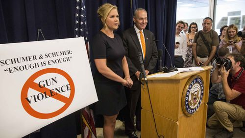 Amy Schumer and Sen. Chuck Schumer (D-NY) appeared today at a press conference in NYC to announce a three-part legislative gun control plan. Source: AFP