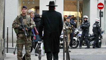 Police officers and French army soldiers patrol Rue des Rosiers street, in the heart of Paris Jewish quarter. (AP)