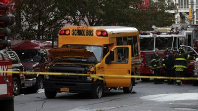 Six people died at the scene and another two died in hospital. Two children inside the school bus were injured. (AP)