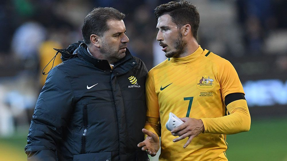 Ange Postecoglou and Mathew Leckie.