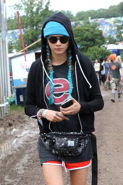Cara Delevingne worked colourful extensions. The hoodie and beanie, however, made it more Glastonbury grit than Palm Springs sunny.