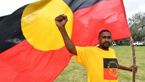 Earl Gordon protests ahead of the Commonwealth Games at The Spit. (AAP)