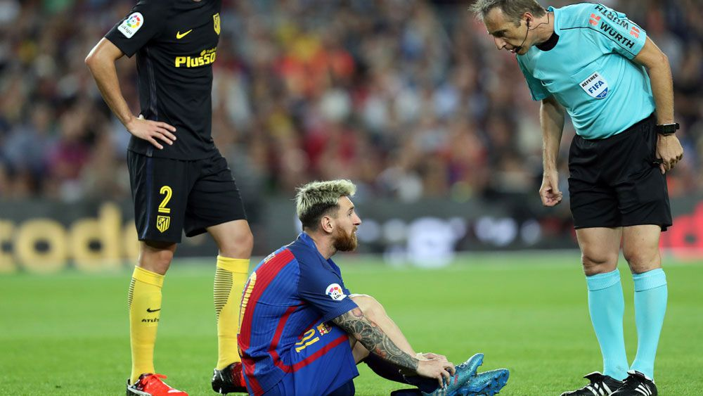 Lionel Messi suffers an abductor muscle injury against Atletico Madrid.(AFP)