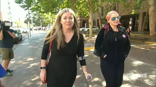Juanita and Angela were in court today as their attacker pleaded not guilty to the fresh charges. (9NEWS)