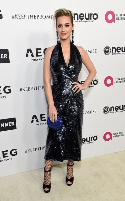 "In the style stakes, unlike her bubbly pop tunes, <a href=""https://style.nine.com.au/2017/03/22/11/30/style_-katy-perry-shoe-line"" target=""_blank"">Katy Perry</a> is just as often a miss as she is a hit but an invitation from rock icon Elton John encouraged her to put her best heel forward in Los Angeles on the weekend.<br> In a fitted sequinned gown paired with fishnet stockings and open-toed heels (not a move for fashion novices) and chandelier earrings beneath her new hairdo, the one she stole from the lead singer of Roxette, Katy owned the red carpet at Elton's 70th birthday bash.<br> Katy had stiff competition from Project Runway host Heidi Klum who supported designer Christian Siriano by wearing one of his creations. Christian got his big break on the US reality program.<br> With Tom Ford also present, this was an impromptu fashion event as style isn't the first thing that comes to mind when thinking about over-the-top Elton."