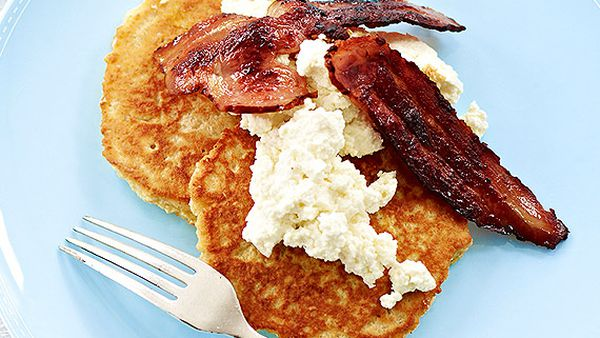 Big oat pancakes with crispy bacon and ricotta