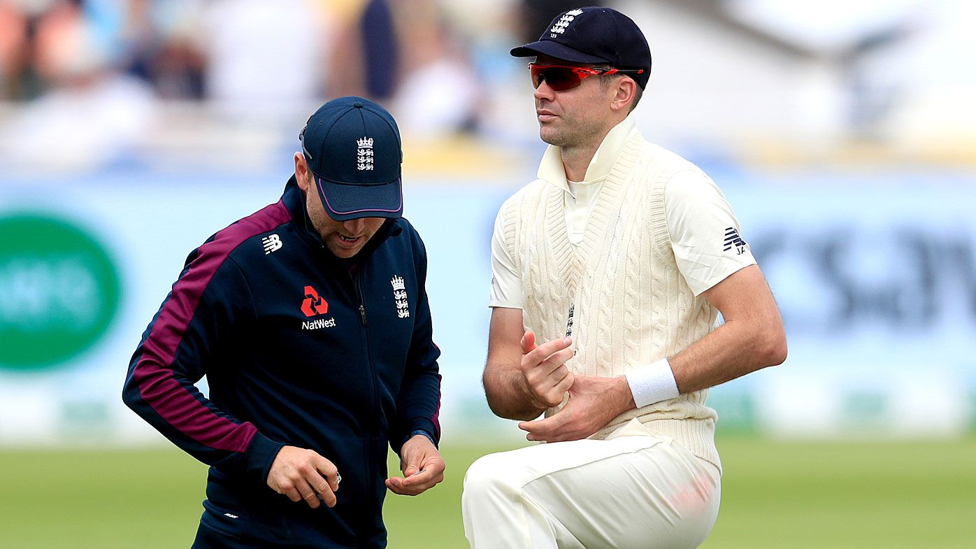 Jimmy Anderson gets treatment during day one of the first Ashes Test