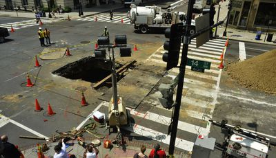 A smaller sinkhole opened up in the middle of the US capital Washington DC in May 2013. (Getty)