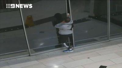Bungling bookstore burglar gets stuck in sliding doors