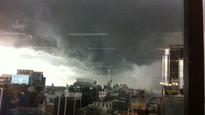 Office workers stepped away from their desks to watch the storm roll in. (Neela Mistry)