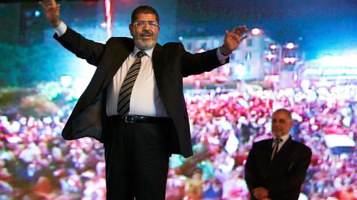 Morsi in 2012, holding a rally in Cairo.