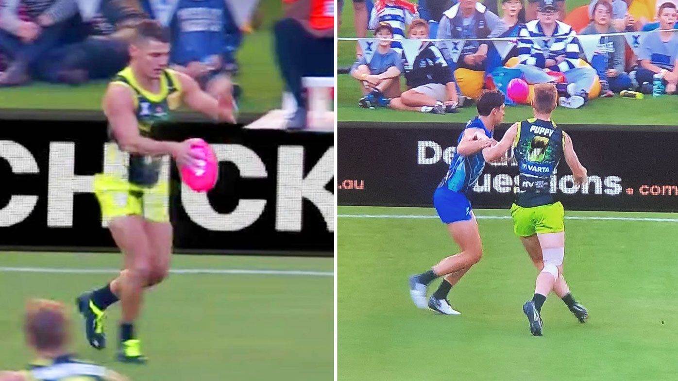 AFLX players clash with the green screen