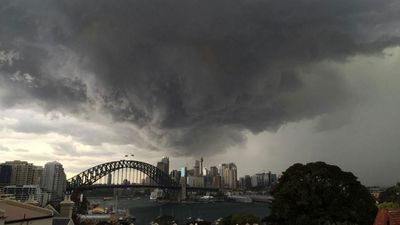 Heavy rain has lashed the state, plunging Sydney CBD into darkness in a matter of minutes. (@oknermin)