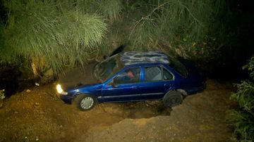 Car flies off embankment, crashes into creek bed after police chase