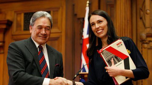 Zealand First leader Winston Peters, left, and Prime Minister-designate Jacinda Ardern shake hands after signing a coalition agreement October 24. (AAP)