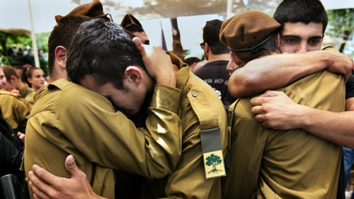Israeli soldiers grieve for a comrade killed during the latest round of Gaza violence. (Getty)