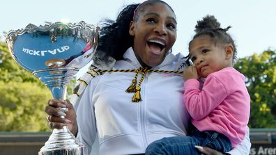 Serena Williams of the USA celebrates with daughter Alexis Olympia after winning the final match against Jessica Pegula
