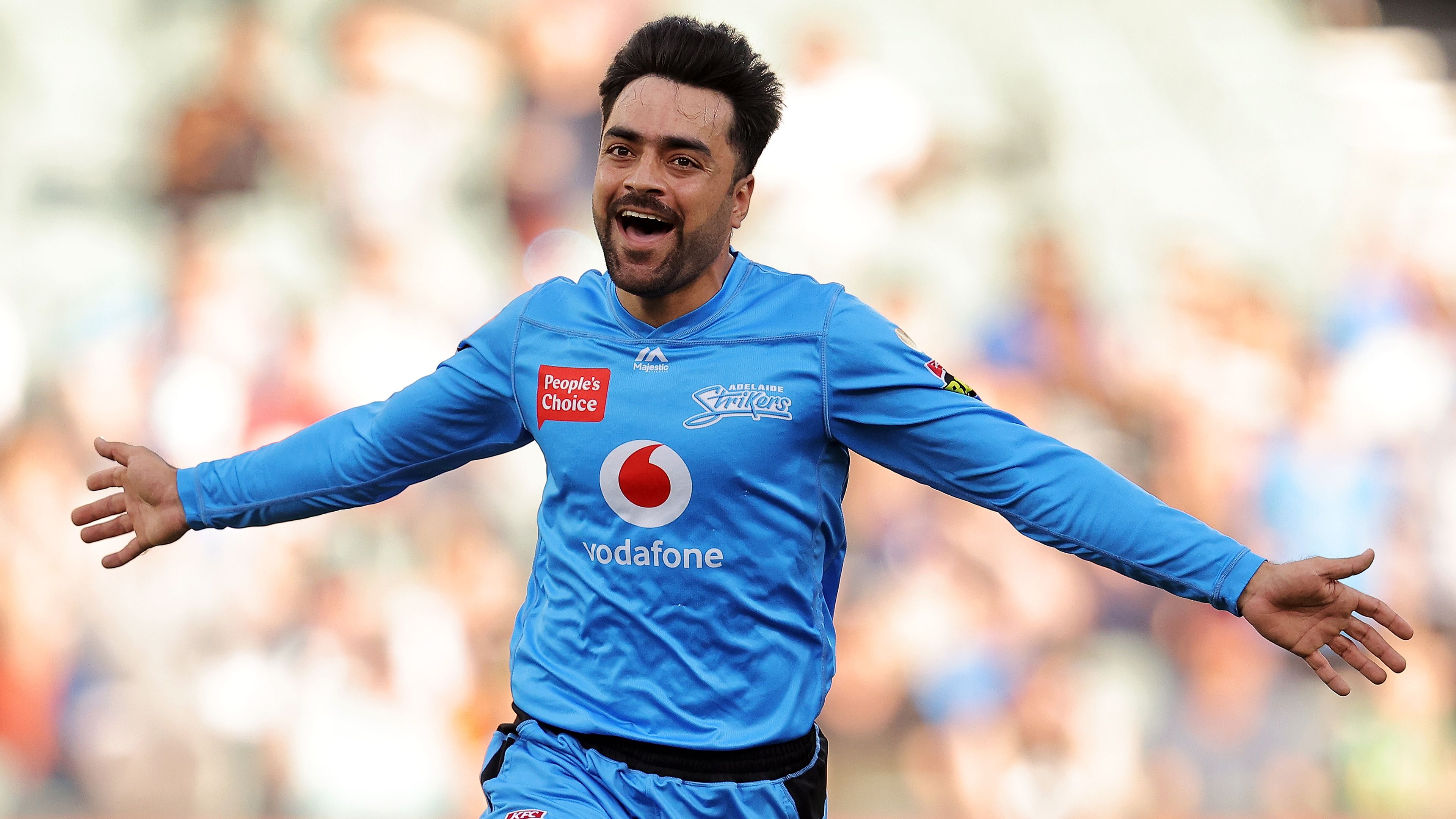Rashid Khan of the Strikers celebrates after taking a wicket.