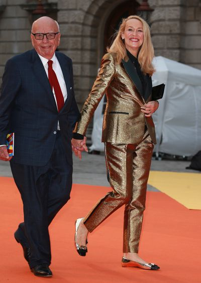 <p>Seventies supermodel Jerry Hall, 60, and media mogul Rupert Murdoch, 86, held hands as they entered the Royal Academy of Arts Summer Exhibition in London.</p> <p>While Rupert wore a conservative suit, he was upstaged by his blonde-maned bride in a gold suit with tuxedo stripes.&nbsp;</p> <p>The surprising couple married in March last year and looked loved-up as they attended the artistic affair which also attracted Florence Welch in Gucci, actor Josh Harnett and Daisy Lowe in a revealing black dress.</p> <p>&nbsp;</p>