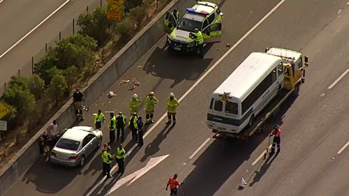 Two people have been rushed to hospital and another 20 assessed by paramedics following a multi-car and school bus crash on a highway southwest of Brisbane.