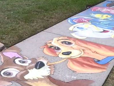 Brian Morris does Disney chalk drawings on his street footpath in Florida