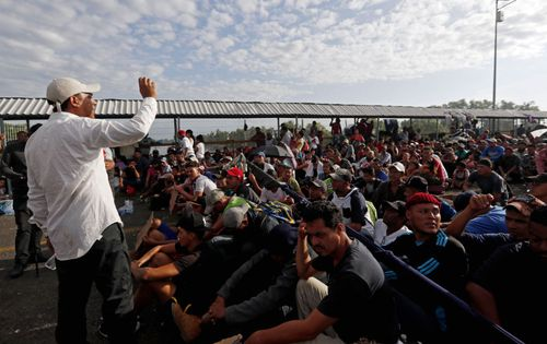Honduran migrants wait on the bridge between Tecun Uman, Guatemala, and Mexico.
