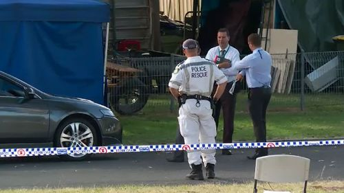 Police canvassed the area outside the Unanderra home.