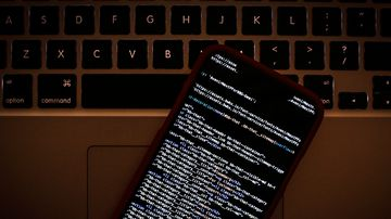 HTML code is seen on a smartphone.
