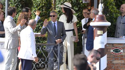 George Clooney and his wife Amal Alamuddin leave Hotel Cipriani for their civil ceremony at Venice City Hall. (All images Getty)