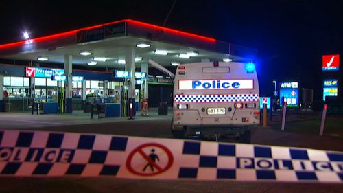 Police at the service station. (9NEWS)
