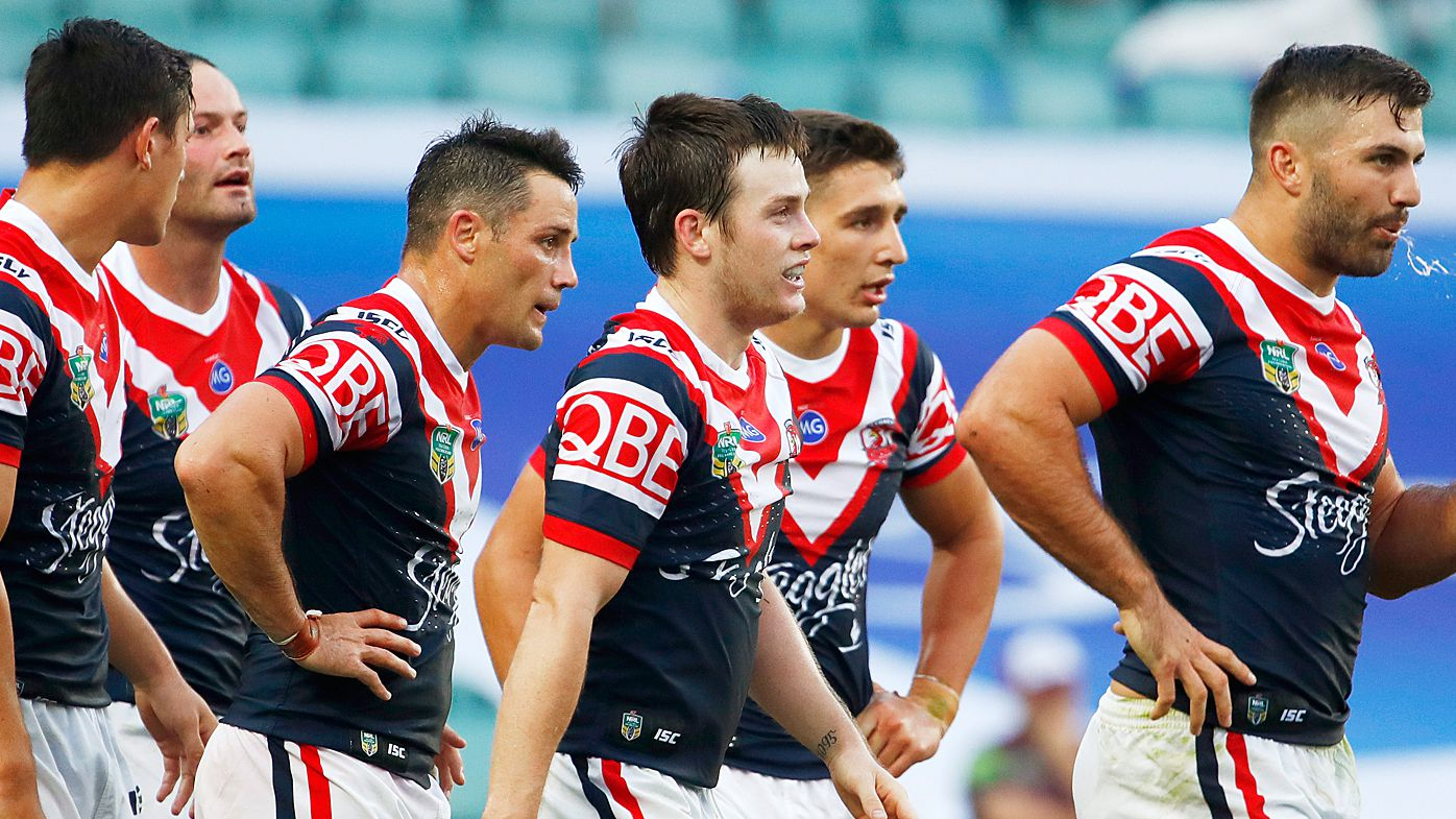 Roosters players look on