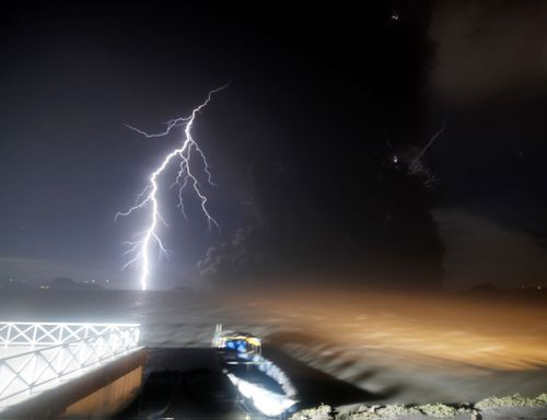 As tremors shook the area, volcanic lightning flickered in the column of steam and ash.