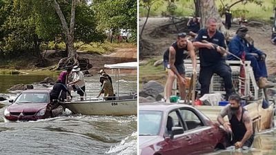 Dramatic rescue from croc-infested river