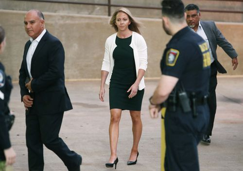 Former Dallas police officer Amber Guyger is escorted by a security detail as she arrives for her murder trial at the Frank Crowley Courthouse in downtown Dallas.