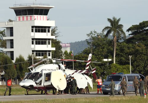 The fifth boy is loaded in to the air ambulance. Picture: AP