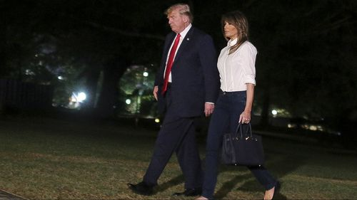 Donald and Melania Trump arrive at the White House after their Europe trip. (AAP)