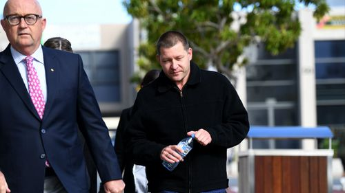 Thunder River Rapids ride operator Peter Nemeth (right) and his lawyer Ralph Devlin QC arrive for the inquest into the Dreamworld disaster. Picture: AAP