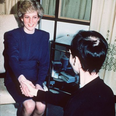 Princess Diana shakes hands with an AIDS patient