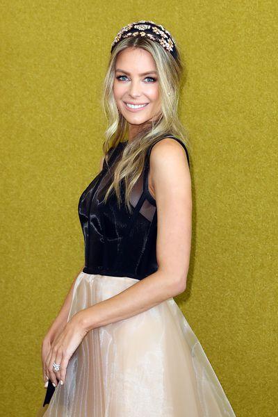 Jennifer Hawkins in an Alex Perry dress and headpiece fromEzara/J