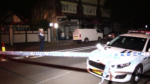 Police believe man found lying in middle of Sydney street was assaulted