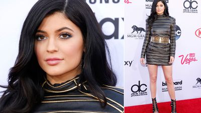 Kylie Jenner wore a black and gold leather mini dress. (AAP)