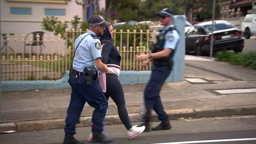 A woman was taken into custody after allegedly assaulting a 9News journalist after a police pursuit in Sydney.