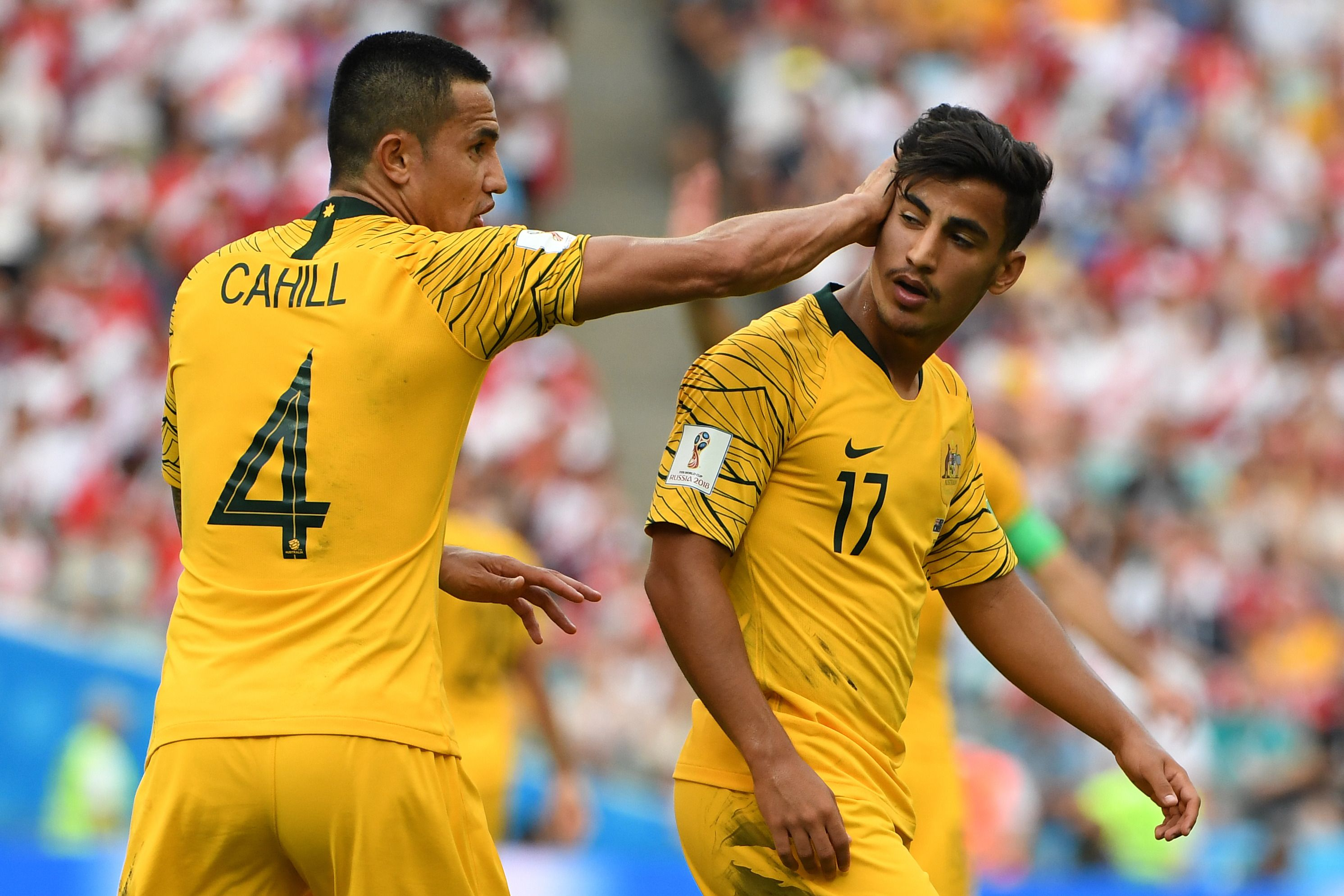 Daniel Arzani gets a pat on the head from Tim Cahill.