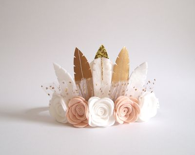 """<a href=""""https://www.etsy.com/au/listing/453698474/neutral-rose-feather-crown-full-size?ga_order=most_relevant&amp;ga_search_type=all&amp;ga_view_type=gallery&amp;ga_search_query=flower%20crowns&amp;ref=sr_gallery_5"""" target=""""_blank"""" draggable=""""false"""">Kirei Handmade Neutral Rose Feather Crown, $38.</a>"""