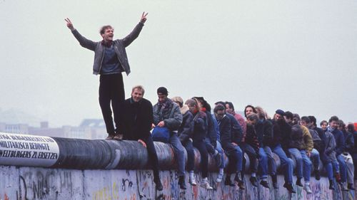West Germans Celebrate The Unification Of Berlin Atop The Berlin Wall During The Collapse Of Communism In East Berlin On November 12, 1989.  (Photo By Stephen Jaffe/Getty Images)